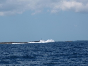 Waves crashing on Whale Cay as we transit the channel